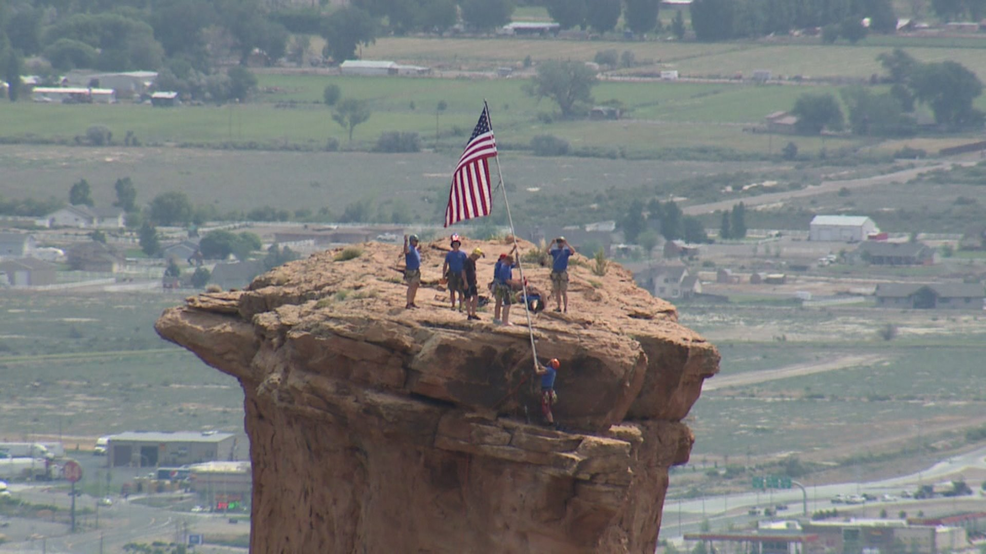 Raising Old Glory on Independence Monument