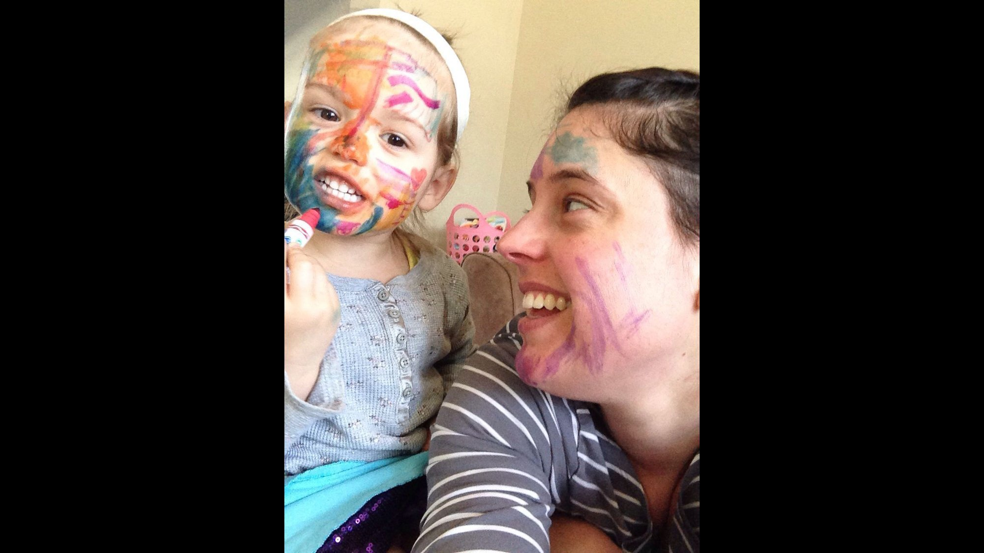 """""""One of my proudest moments as a mother: Letting my 3-year-old daughter color on my face. When she asked to color me, this gave me a new 'aha moment': Live a little, even out of my comfort zone."""" -- Tanya Wilson, St. Thomas, Ontario"""