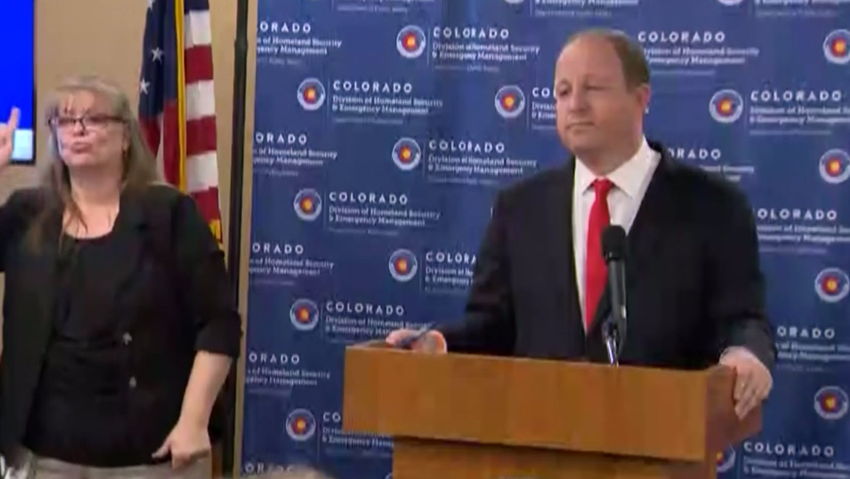 Colorado Gov. Jared Polis holds a COVID-19 news conference on March 27, 2020.