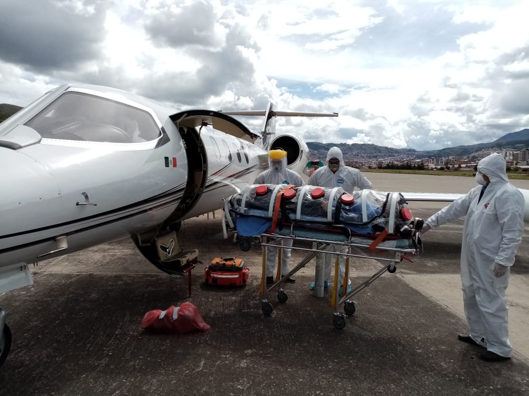 A 72-year-old Colorado man who was visiting Peru and contracted COVID-19 is loaded into a Jet Rescue Air Ambulance plane.