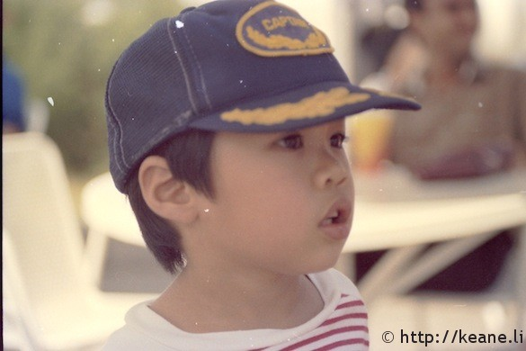Me with a captain's cap at Ocean Park in the 1980s