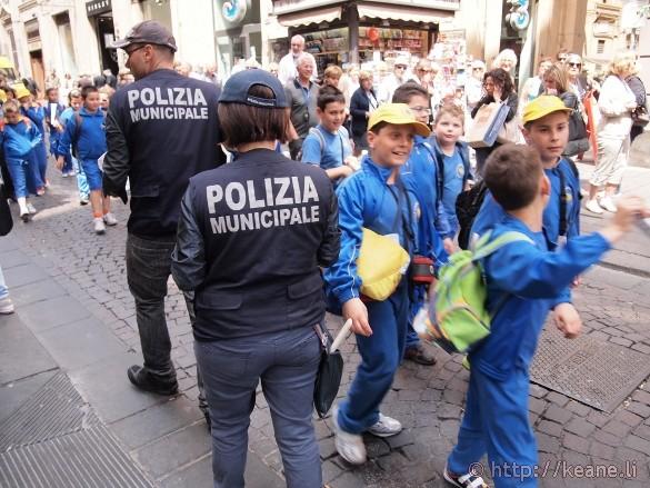 The Polizia Municipale and a group of school children along Via Toledo in Naples
