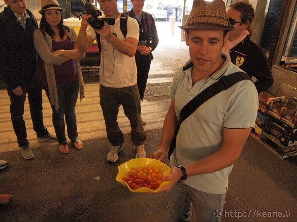 Eating Italy Food Tours - Sampling tomatoes in Mercato Testaccio