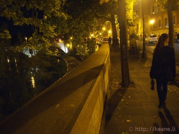 Rome in the Rain - Girl walking along the Tevere at Night