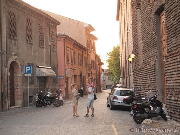 Father and child in Rimini's Centro Storico at sunset