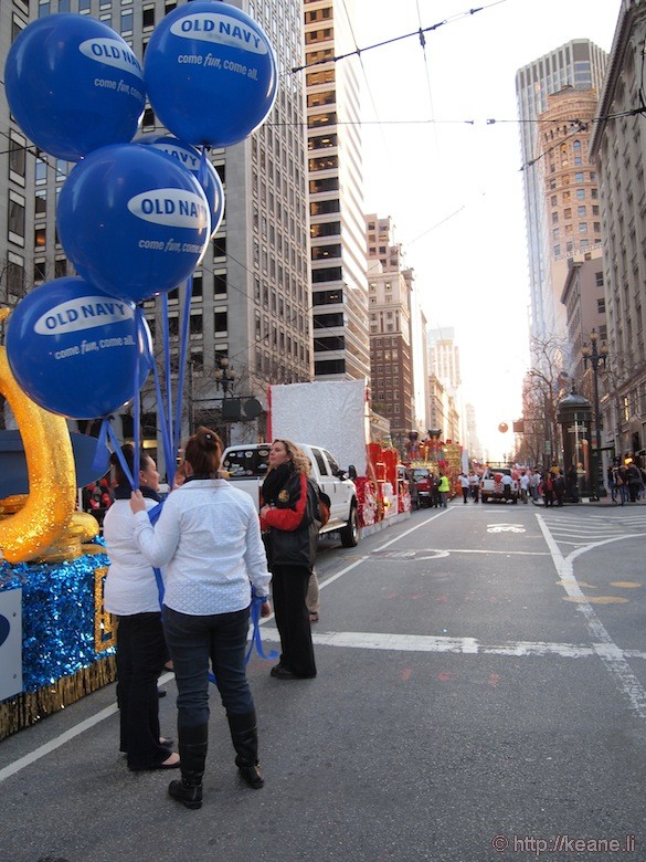 Old Navy balloons on Market Street during sunset before the Chinese New Year parade