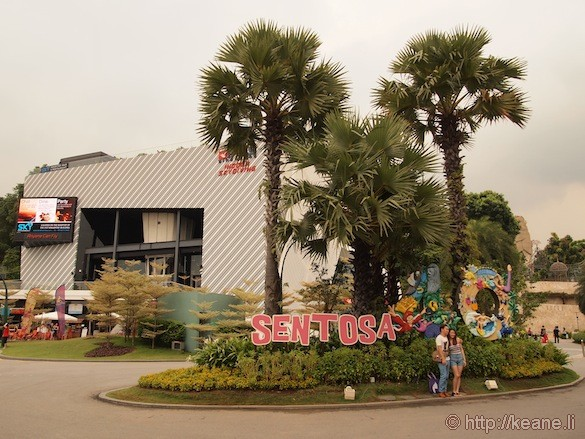 Sentosa Island in Singapore - Couple in front of sign