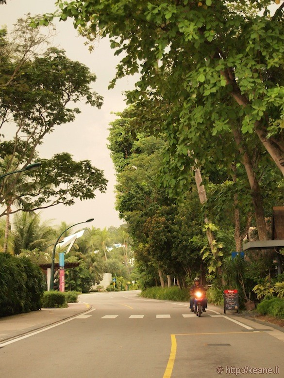 Sentosa Island in Singapore - Man on motorcycle in rain