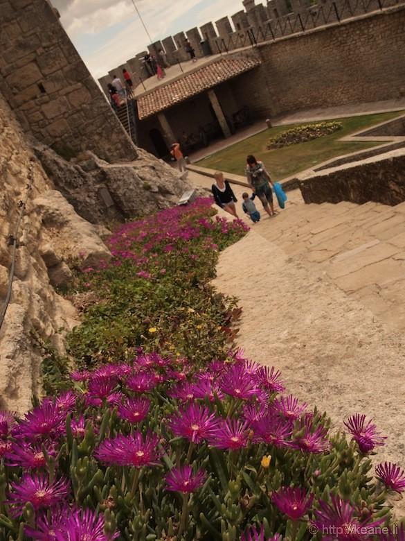 Flowers and Courtyard Inside Guaita Castle in San Marino