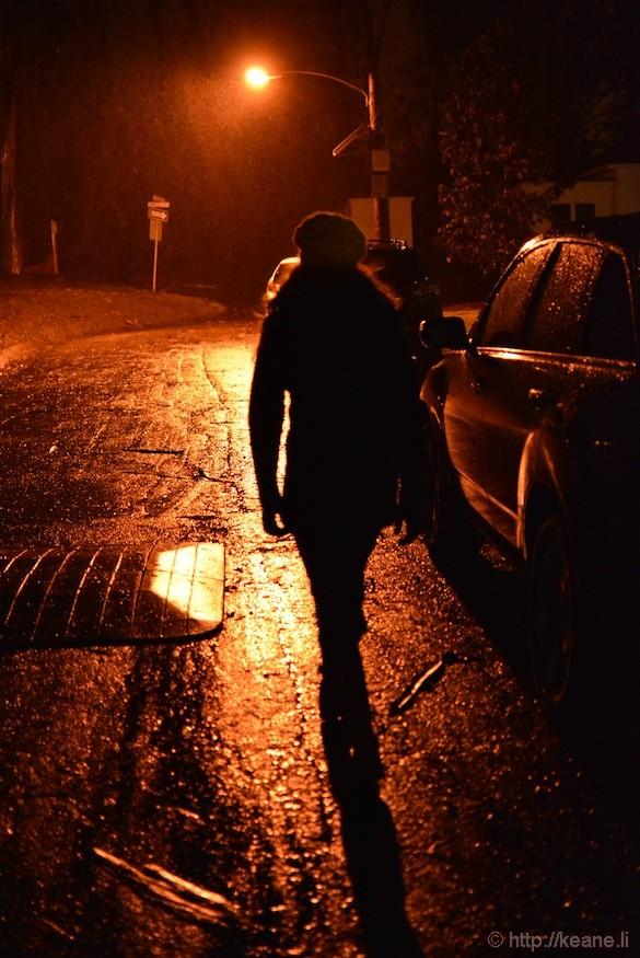 Girl at night in Presidio in the rain