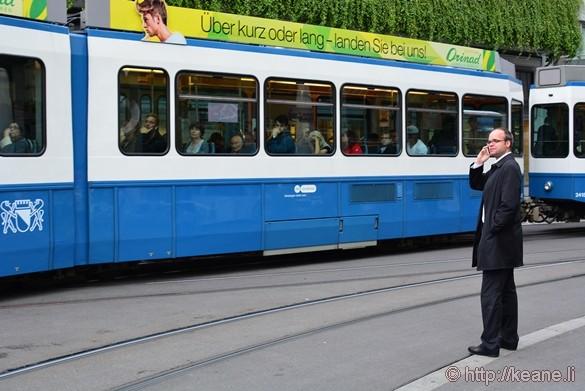 Man Waits for Tram in Zürich