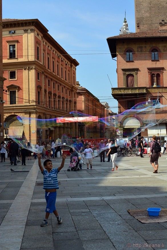 Boy Plays with Giant Bubble in Piazza del Nettuno