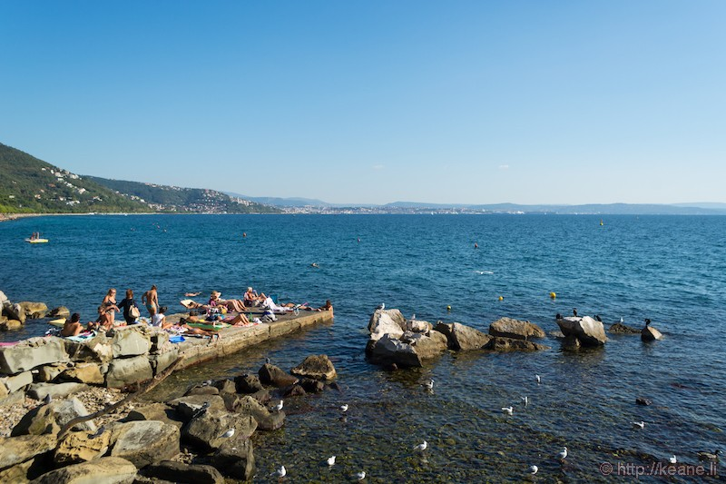 Sunbathers by the Gulf of Trieste