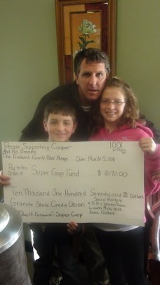 Donation check to the Super Coop Fund