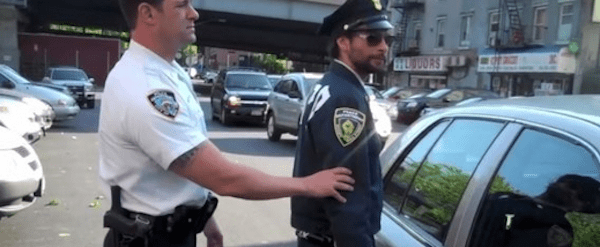 Arrested For Satirizing Police Repression