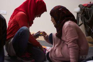 2 girls sharing colour pencil