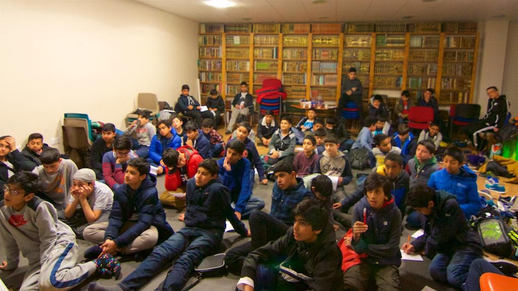 boys sitting in a hall