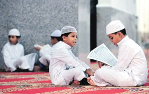 boys reading Quran to each other