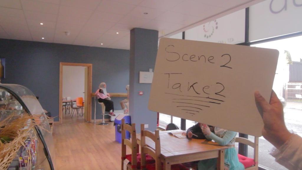 writing of scene 2 take 2 on whiteboard