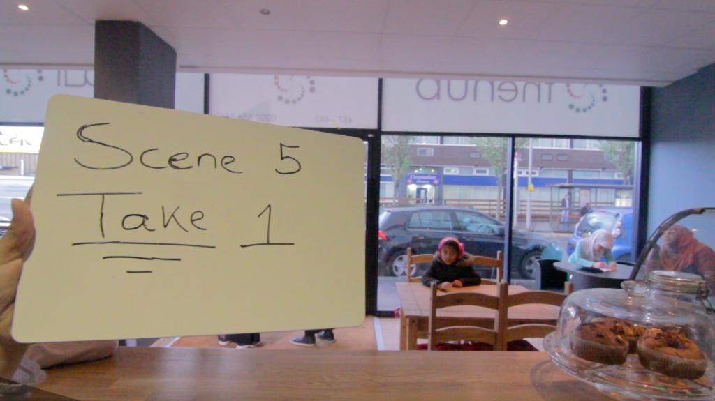 writing of scene 5 take 1 on whiteboard