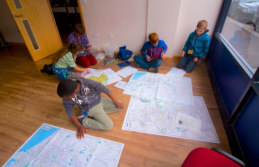 group of people looking at map