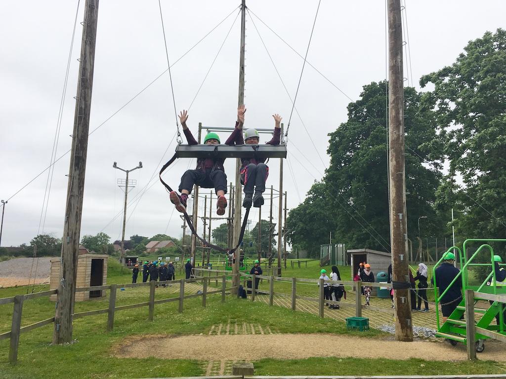 2 people sitting on 3g swing