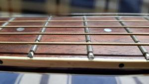 Lowering action on an acoustic guitar