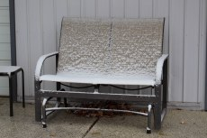 Just our luck. We start to bring out the lawn furniture and it snows.