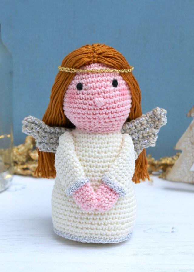Crochet angel amigurumi against a blue background