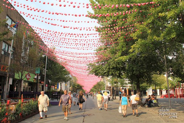 A street with three names: Montreal Gay Village, The Village and Le Village Gai.