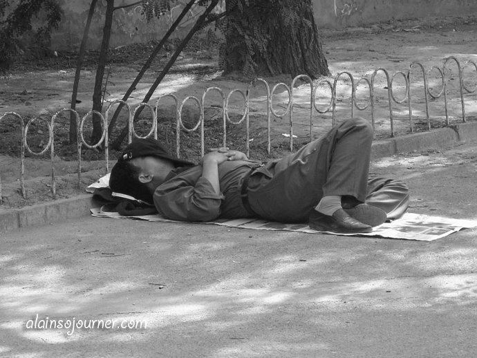 This Life in China Series - Napping Outdoors starts with me (pretending) sleeping in one of the benches outside the East gate of the Forbidden City.