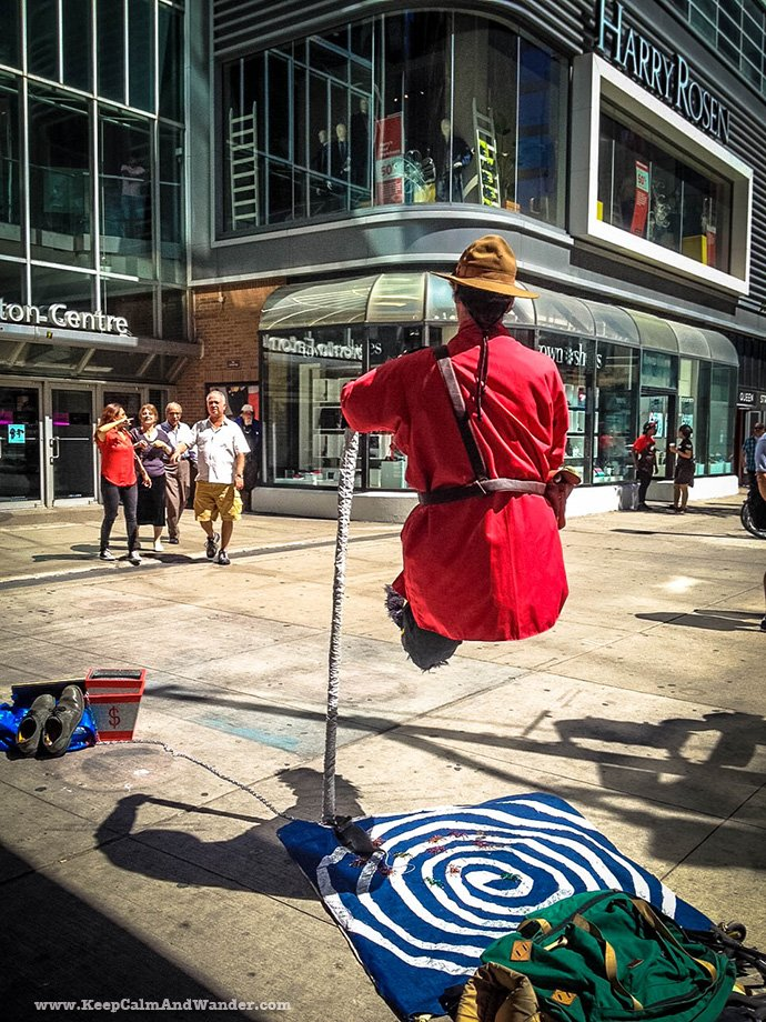 This RCMP officer floating busker is so comfortable in his invisible chair!