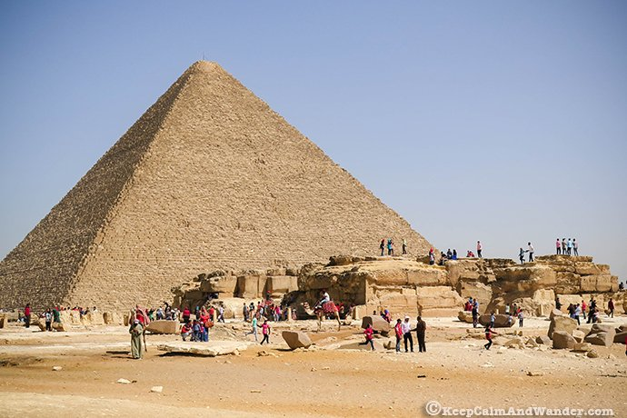 Photos of People Climbing the Great Pyramids of Giza in Egypt.