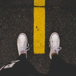 Sneakers on yellow line