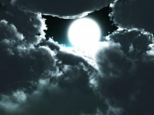 the light of the full moon peeking thru the clouds, inspiration