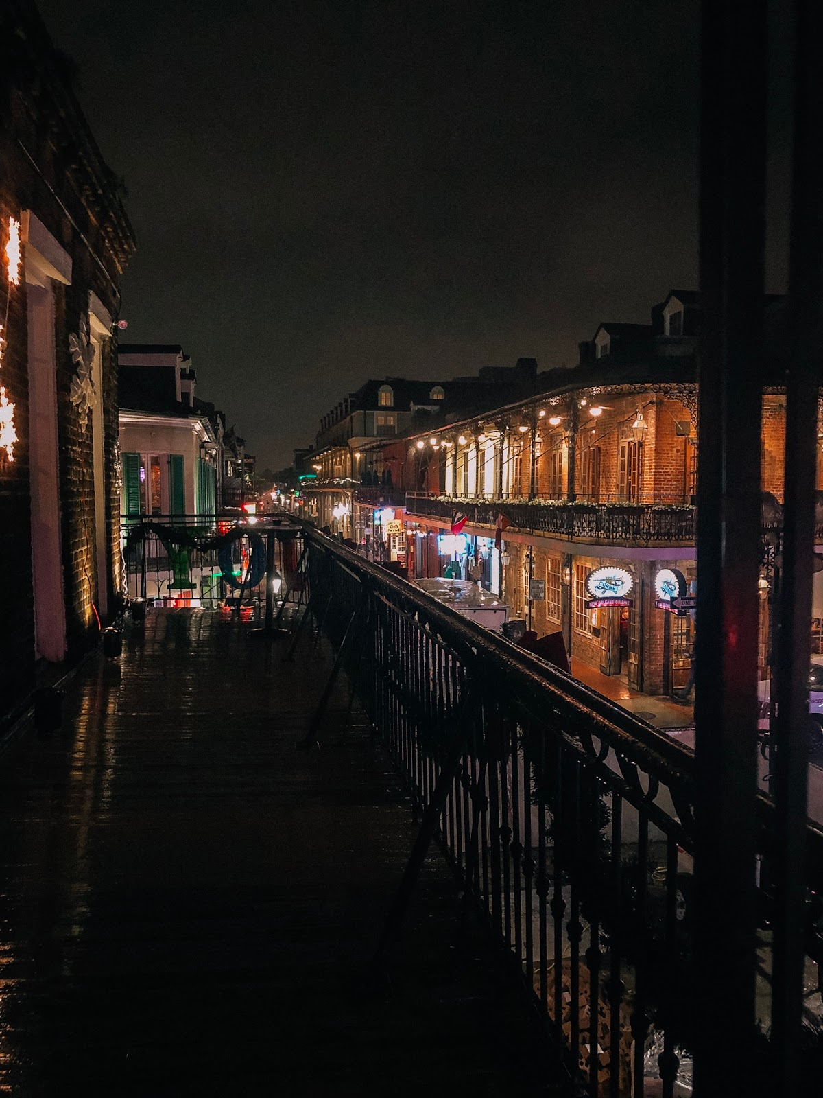 Night view of Bourbon Street lit up in New Orleans