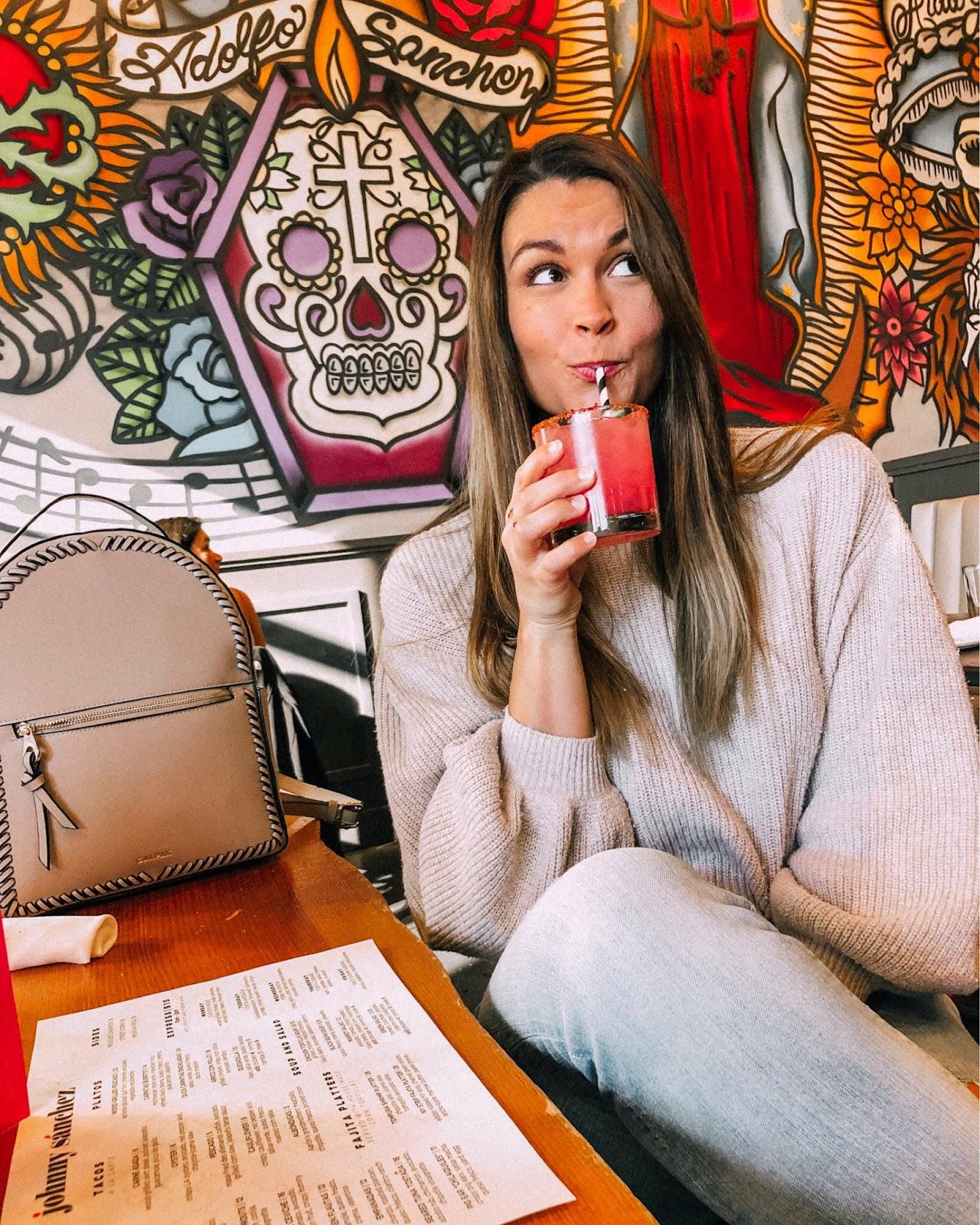 Travel blogger enjoying a spicy margarita at Johnny Sánchez in New Orleans