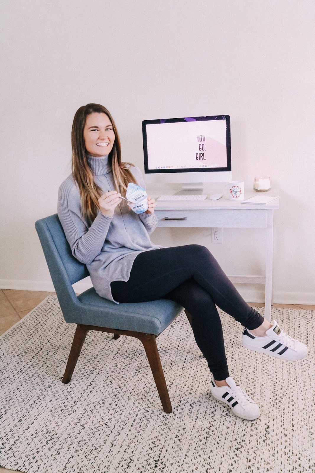 Tampa blogger enjoying Chobani Less Sugar Greek Yogurt in her home office