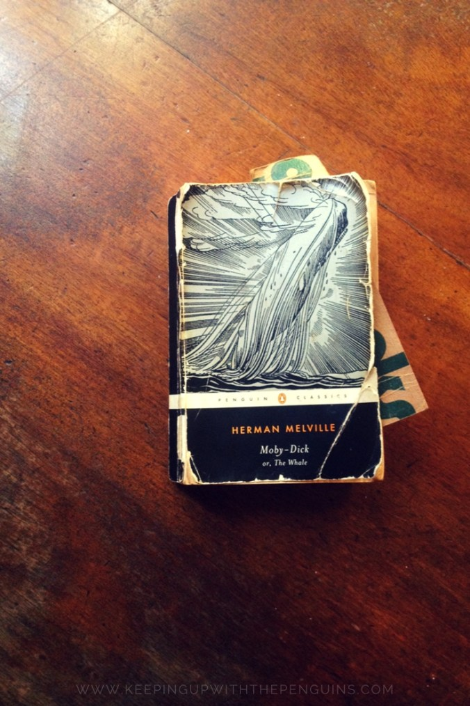 Moby Dick - Herman Melville - book laid on wooden table - Keeping Up With The Penguins