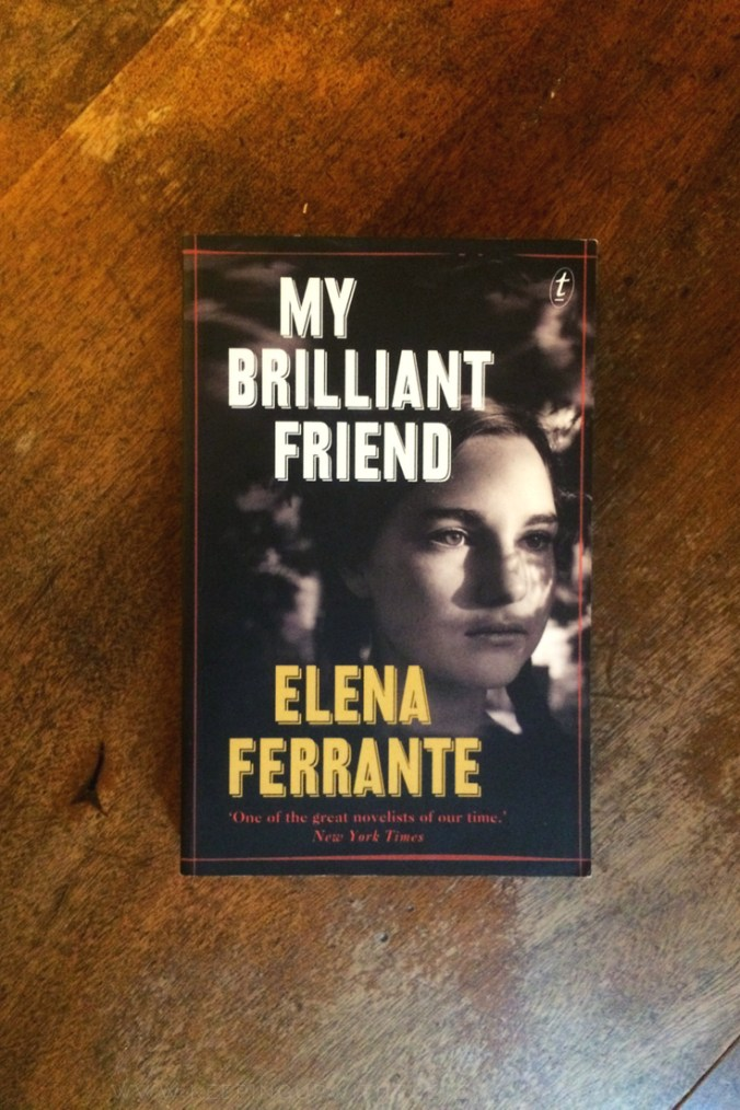 My Brilliant Friend - Elena Ferrante - Book Laid On Wooden Table - Keeping Up With The Penguins