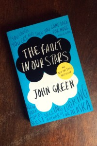 The Fault In Our Stars - John Green - Book Cover Laid On Wooden Table - Keeping Up With The Penguins