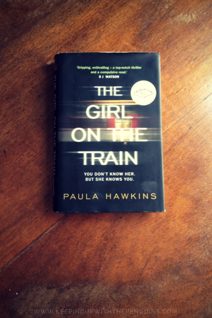 The Girl on the Train - Paula Hawkins - book laid on wooden table - Keeping Up With The Penguins