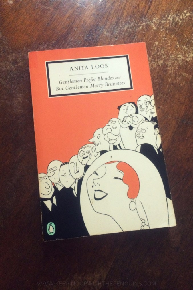 Gentlemen Prefer Blondes - Anita Loos - Books Laid on Wooden Table - Keeping Up With The Penguins