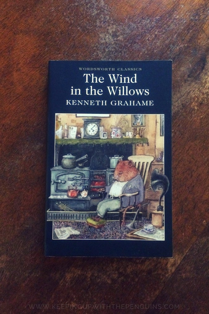 The Wind In The Willows - Kenneth Grahame - Book Laid on Wooden Table - Keeping Up With The Penguins