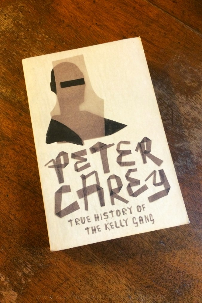 True History Of The Kelly Gang - Peter Carey - Book Laid on Wooden Table - Keeping Up With The Penguins