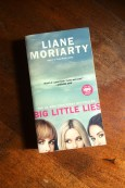 Big Little Lies - Liane Moriarty - Book Laid On Wooden Table - Keeping Up With The Penguins