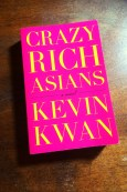 Crazy Rich Asians - Kevin Kwan - Book Laid on Wooden Table - Keeping Up With The Penguins