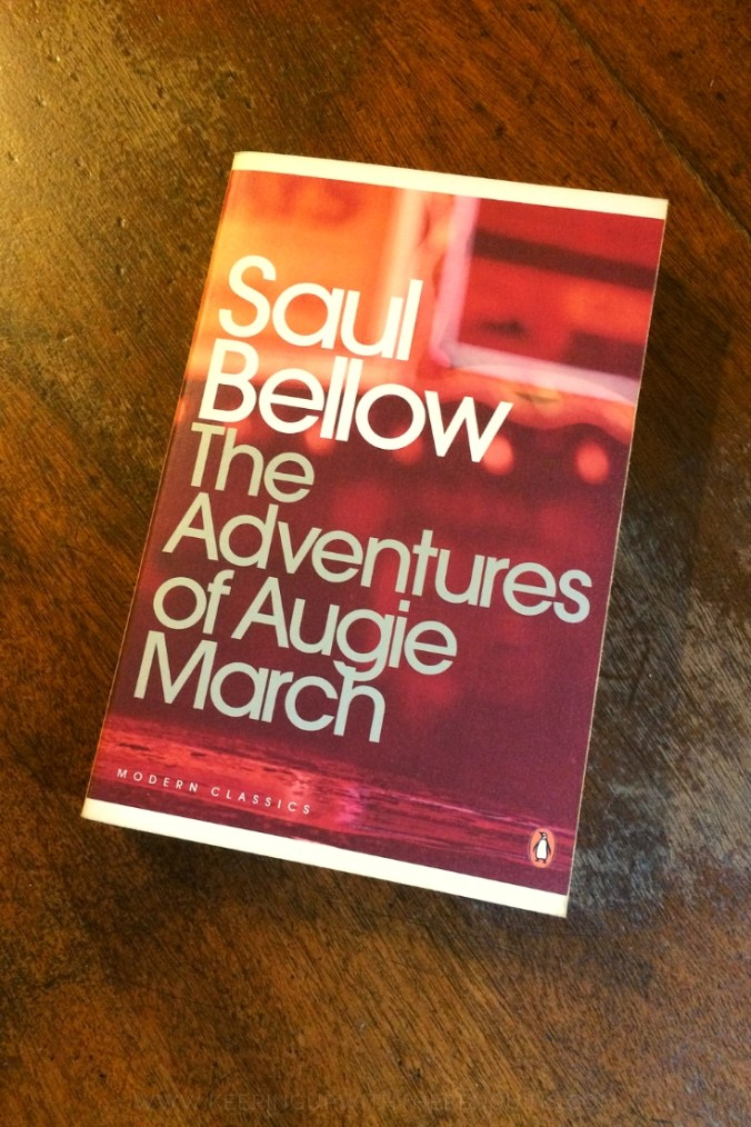 The Adventures of Augie March - Saul Bellow - Book Laid on Wooden Table - Keeping Up With The Penguins