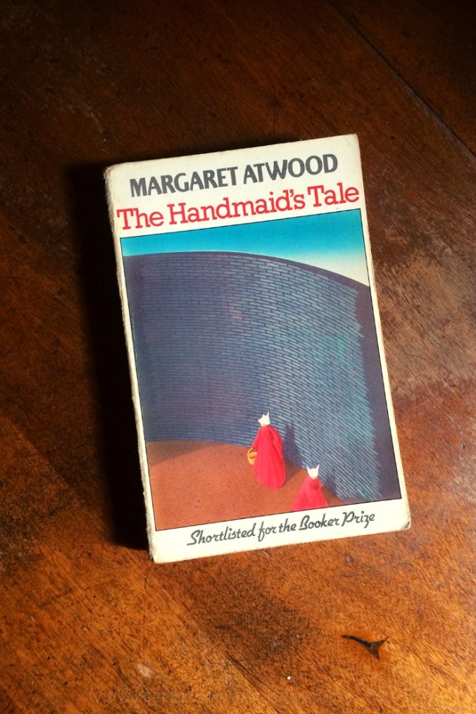 The Handmaid's Tale - Margaret Atwood - Book Laid on Wooden Table - Keeping Up With The Penguins
