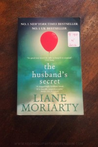 The Husband's Secret - Liane Moriarty - A Book Laid on Wooden Table - Keeping Up With The Penguins